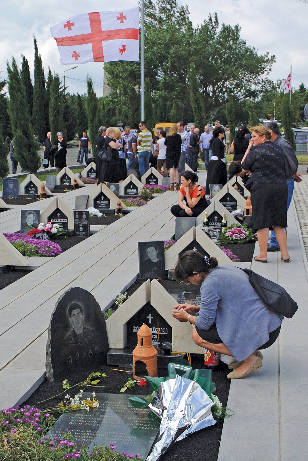 Georgians visit a military cemetery in Tbilisi in August 2013 during a ceremony in memory of the 2008 war with Russia. The war marked the use of cyber attack as part of a wider military strategy. [AFP/GETTY IMAGES]