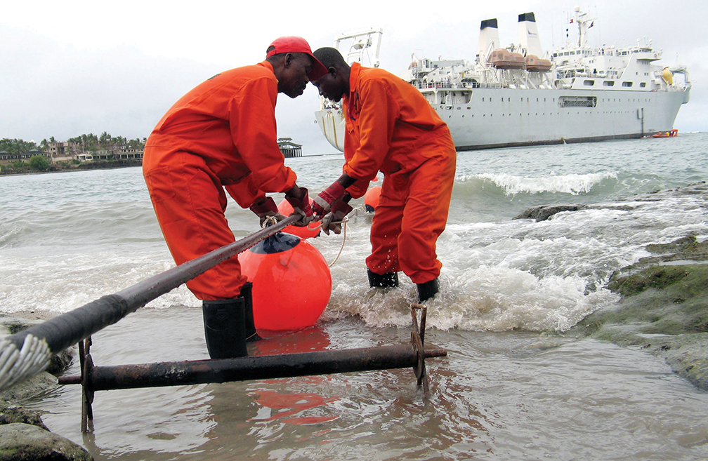 Workers lay fiber optic cables near the coastal city of Mombasa, Kenya, in June 2009. Eleven undersea fiber-optic cables have been laid in Africa in the last few years, providing faster and more affordable Internet connections.  [REUTERS]