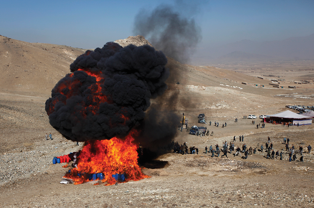 Afghan policemen burn over 20 tons of narcotics seized by Afghan Security Forces in Kabul in November 2013.