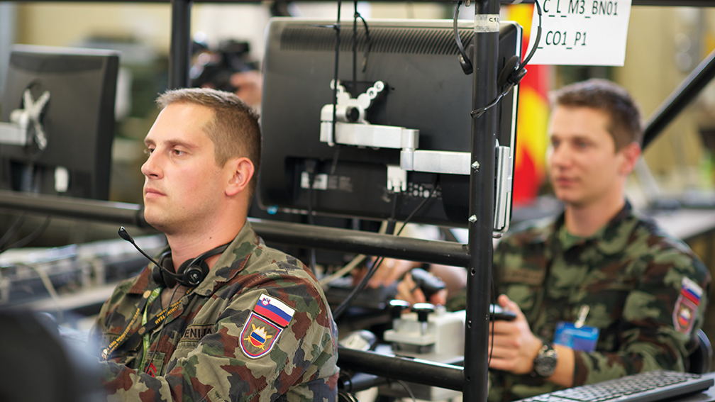 Slovenian soldiers operate information systems during Combined Endeavor in Grafenwöhr, Germany. [EUCOM]
