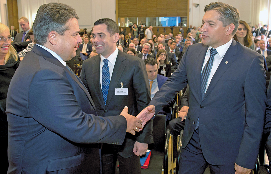 German Minister of Economics Sigmar Gabriel, left, greets Arben Ahmetaj, center, the Albanian minister of economics, and Besim Beqaj, right, finance minister of Kosovo*, at the conference on trade and commerce in the Western Balkans in Berlin in August 2014.