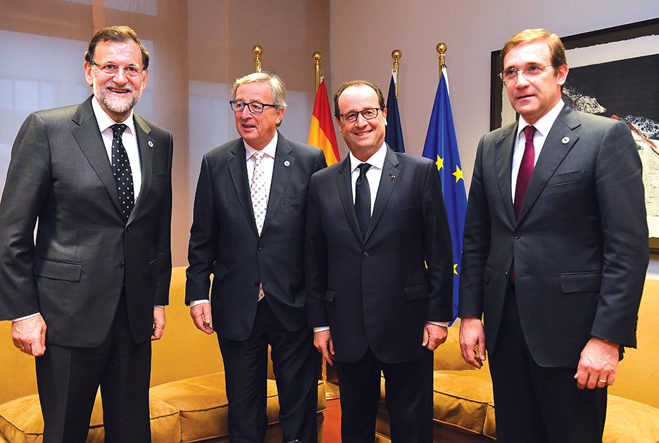(L-R) Spanish Prime Minister  Mariano Rajoy Brey, European Commission President  Jean-Claude Juncker, French President  Francois Hollande and Portuguese Prime Minister Pedro Passos Coelho meet aside at the European Council meeting in Brussels, on December 18, 2014. The EU agreed Thursday to ban all investment in Crimea and cruise ships from its ports as further punishment for Russia's annexation of the region from Ukraine in March. AFP PHOTO/ POOL/Emmanuel Dunand        (Photo credit should read EMMANUEL DUNAND/AFP/Getty Images)