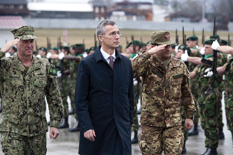 North Atlantic Treaty Organization (NATO) Secretary General Jens Stoltenberg (C) reviews an honor guard of the NATO-led peacekeeping mission in Kosovo (KFOR) in Pristina during his first visit to Kosovo on January 23, 2015. AFP PHOTO / ARMEND NIMANI        (Photo credit should read ARMEND NIMANI/AFP/Getty Images)