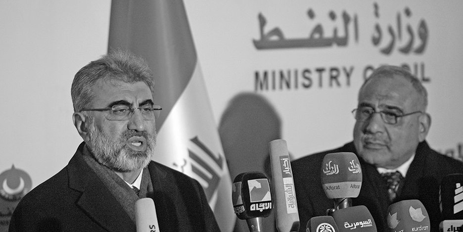 Turkey's Energy Minister Taner Yildiz (L) speaks during a news conference with Iraq's Oil Minister Adel Abdel Mehdi in Baghdad January 18, 2015. Iraq's Oil Minister told reporters on Sunday that Iraq plans to export 375,000 barrels of oil per day (bpd) for the first three months of 2015 from around the northern city of Kirkuk and the Kurdistan region.  REUTERS/Khalid al-Mousily (IRAQ - Tags: CIVIL UNREST POLITICS ENERGY) - RTR4LWK7