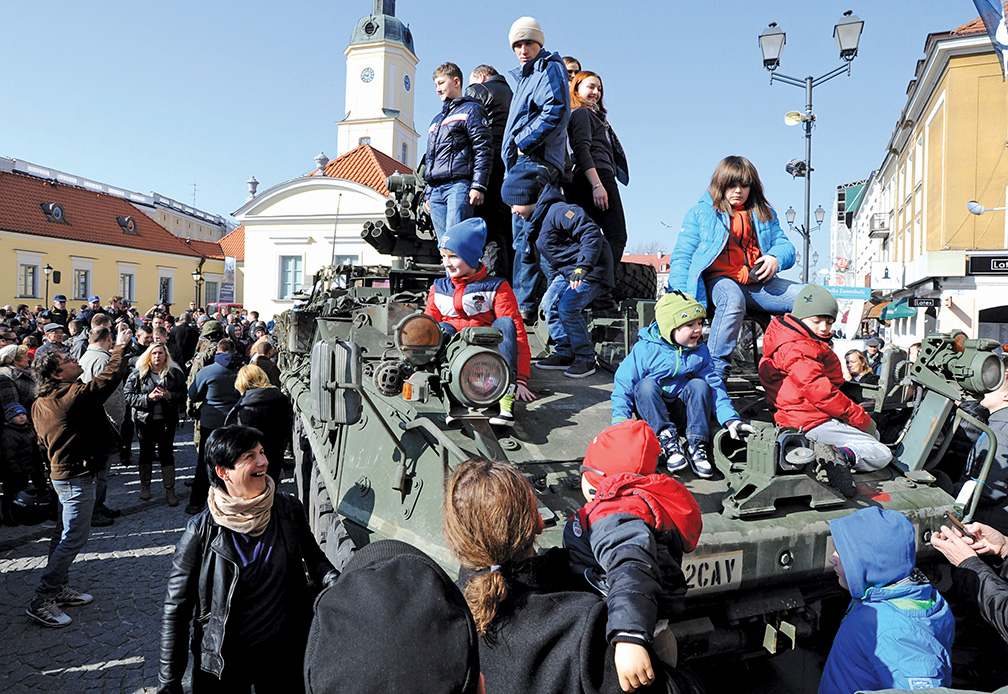 "People surround a group of US Army Stryker armored vehicles from the 3rd Squadron of the 2nd Cavalry Regiment, during a stop on the Kosciuszko Market Square to meet residents, in Bialystok, Poland, Tuesday, March 24, 2015, as they drive back from the Atlantic Resolve exercise. The ""Dragoon Ride"" convoy, designed to show NATO's readiness to defend its members, started last week from Estonia and passed through Latvia and Lithuania before entering Poland on its way to the base in Germany. (AP Photo/Alik Keplicz)"