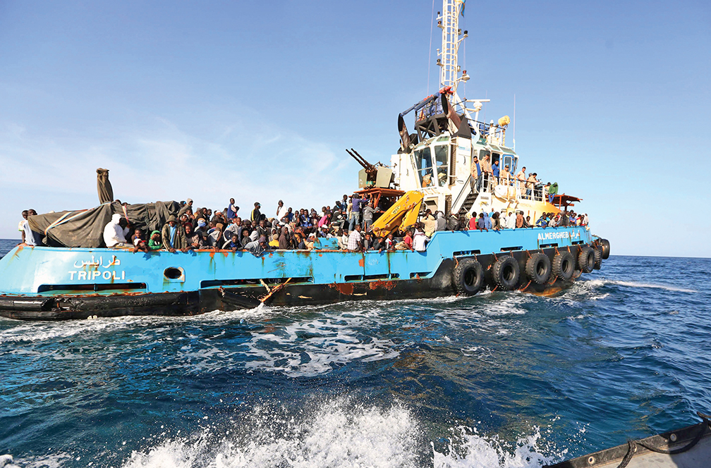 A Libyan coastguard boat carrying mostly African migrants arrive at the port in the city of Misrata on May 3, 2015, after the coastguard intercepted five boats carrying around 500 people trying to reach Europe. Today's incident came as the Italian coastguard rescued more than 2,150 people in the Mediterranean a day after saving nearly 3,700. Several hundred migrants, mostly Africans but also including many fleeing the civil war in Syria, leave Libya every day on rickety boats hoping to make it to Europe. AFP PHOTO / MAHMUD TURKIA (Photo credit should read MAHMUD TURKIA/AFP/Getty Images)