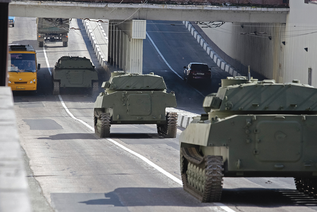 epa04723025 Pro-Russian armored military vehicles drive on a road in Donetsk, Ukraine, 27 April 2015 in preparation for the military parade which will be held in honor of Victory Day on 9 May 2015. Russia on 23 April angrily rejected US accusations that it has deployed more air defence systems in Ukraine and accused Washington of sending military instructors to the country's conflict-torn east. US State Department spokeswoman Marie Harf had said earlier that the Russian military has deployed additional air defence systems into eastern Ukraine, resulting in the highest amount of such equipment in the conflict zone since August 2014. In addition, pro-Russian separatists continue to violate the terms of the Minsk agreement signed in February. EPA/ALEXANDER ERMOCHENKO