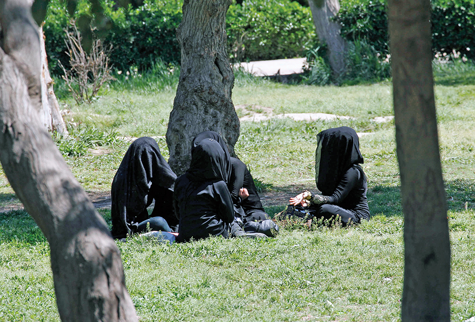 Veiled women chat in a garden in the ISIS-controlled Syrian province of Raqqa in March 2014. ISIS has imposed sweeping restrictions on personal freedoms, especially regarding women, who must follow a strict dress code in public or be punished. REUTERS