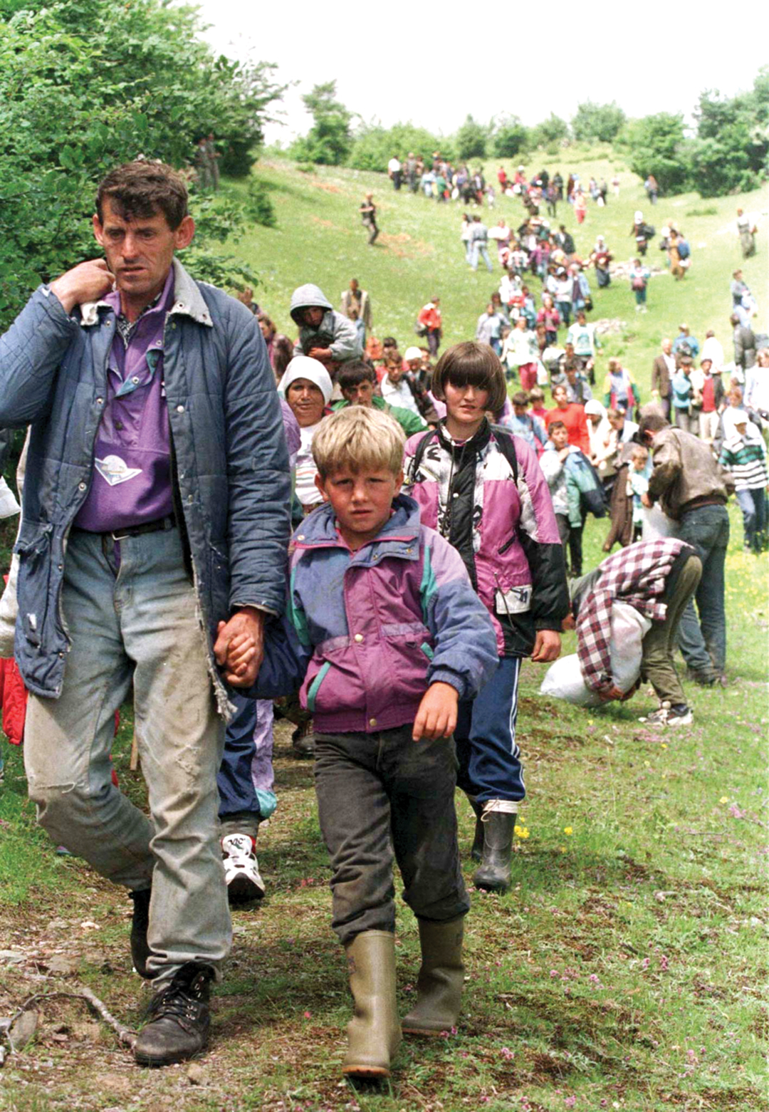 Kosovar refugees flood into Albania in June 1998, fleeing ethnic violence amid clashes between Serb security forces and Kosovar guerrillas. REUTERS