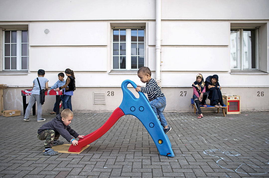 A Bosnian boy, left, plays with an Afghan boy in the courtyard of the former Wilmersdorf town hall in Berlin in August 2015. A large percentage of the refugee flow entering the European Union are from Western Balkan countries such as Bosnia and Herzegovina. AFP/GETTY IMAGES