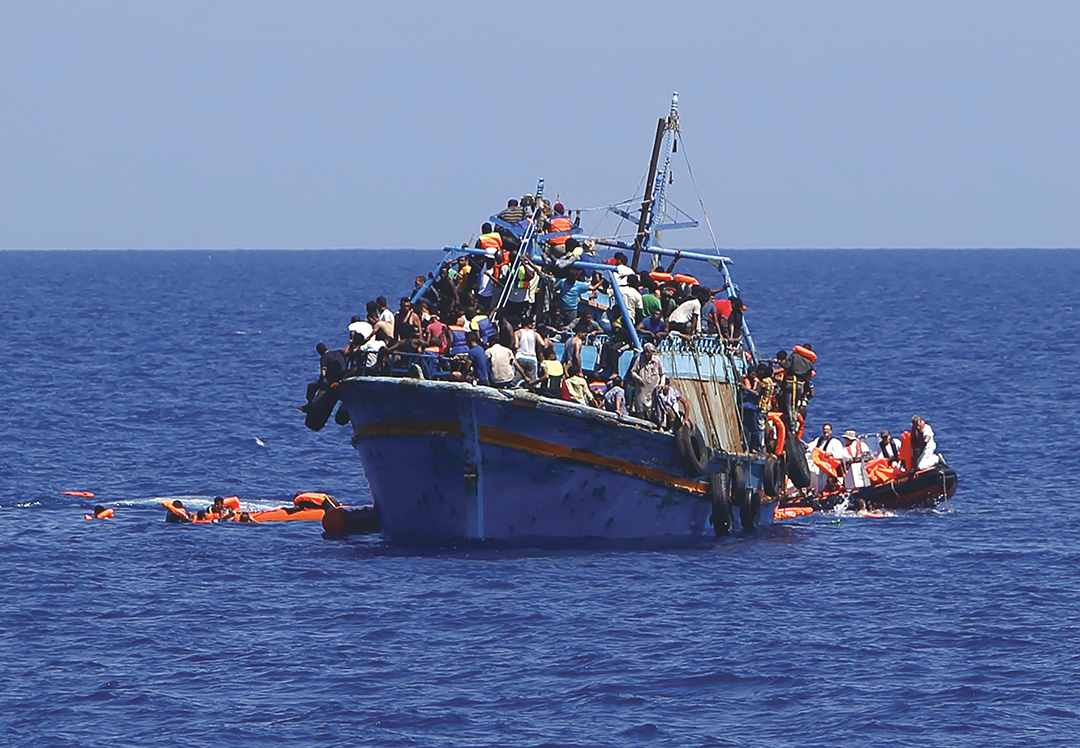 A boat overloaded with migrants is rescued off the coast of Libya in August 2015. [REUTERS]