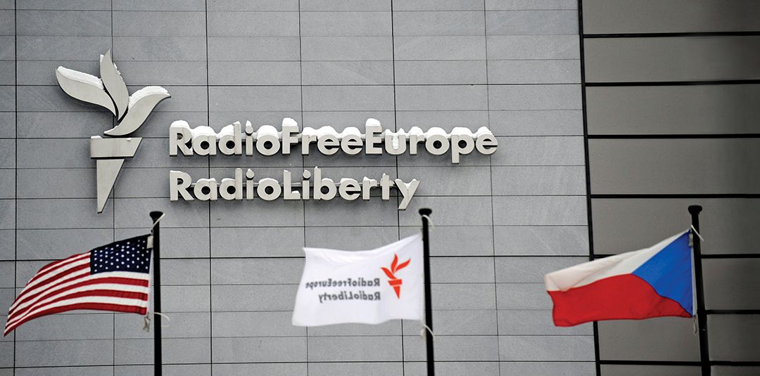 Flags fly in front of the headquarters of Radio Free Europe/Radio Liberty in Prague, Czech Republic. The U.S.-funded station provides an alternative news source to government-controlled media in many countries. THE ASSOCIATED PRESS