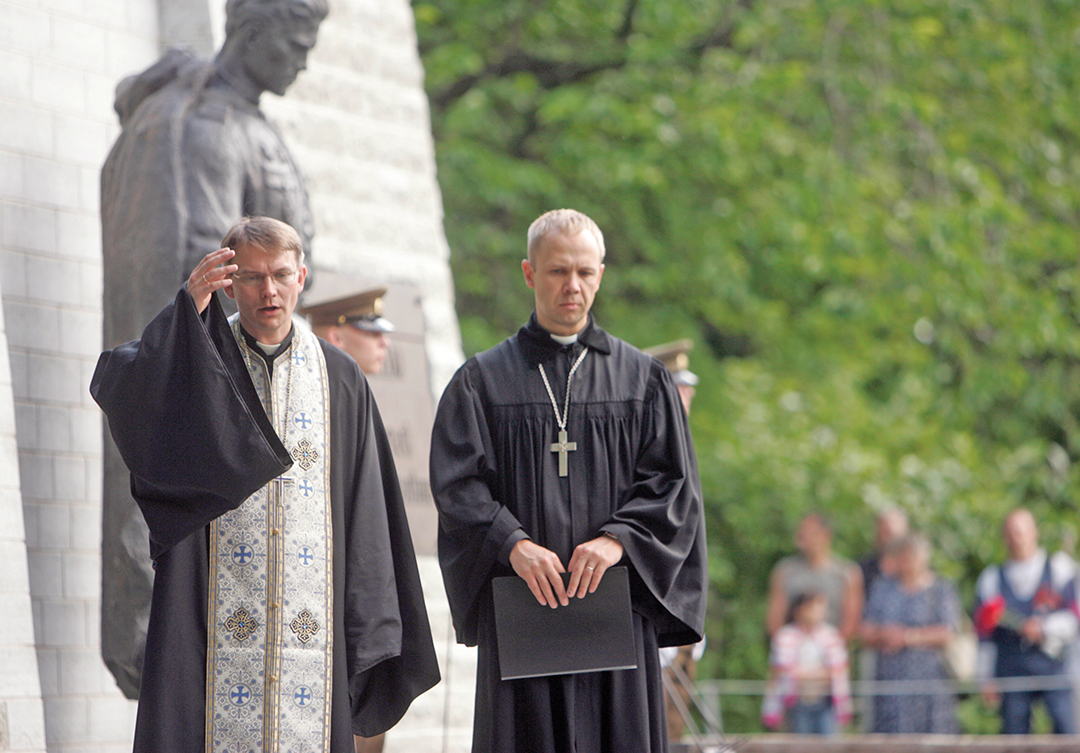 Estonian Army chaplains perform a reburial service for the remains of Russian soldiers moved from the Tallinn city center to a military cemetery in July 2007. REUTERS