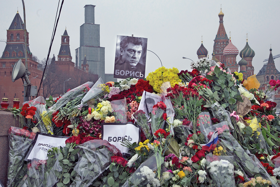 "A makeshift memorial with signs reading ""Propaganda kills!"" and ""Fight!"" is seen near St. Basil's Cathedral in Moscow in March 2015. It's where Boris Nemtsov, a charismatic Russian opposition leader and critic of President Vladimir Putin, was gunned down in February 2015. THE ASSOCIATED PRESS"