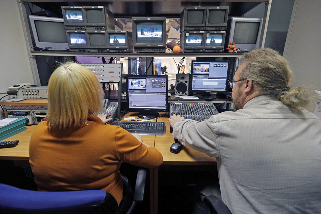 News program directors at the Russian-language First Baltic Channel supervise a broadcast in Riga, Latvia, in January 2015. In response to Kremlin propaganda over Ukraine, the Baltic states are stepping up their own Russian-language broadcasts. REUTERS