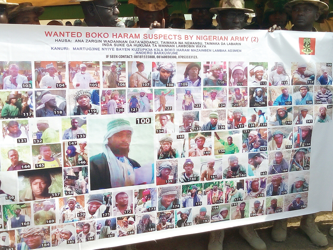 Pictures of 100 wanted Boko Haram suspects are displayed on a poster released by the Nigerian Army in the northeastern town of Damboa in February 2016. AFP/GETTY IMAGES