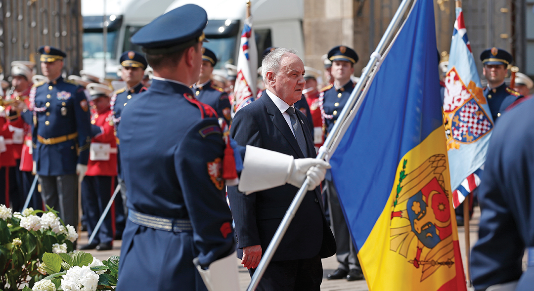 Moldovan President Nicolae Timofti passes an honor guard while attending a meeting of the EU's Eastern Partnership in Prague. Moldova's executive branch has led the push to improve the country's cyber security. THE ASSOCIATED PRESS