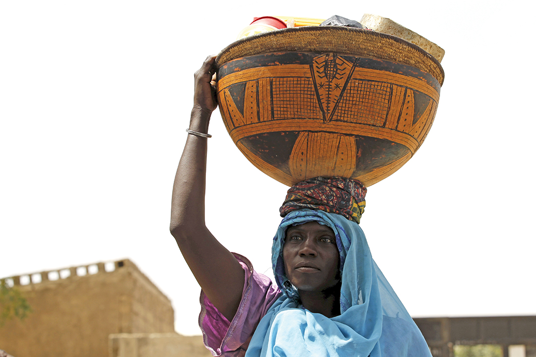 A woman carries a calabash at a camp for internally displaced people in Maiduguri, Nigeria, in March 2016. As many as 2 million people have been displaced by the war with Boko Haram. REUTERS