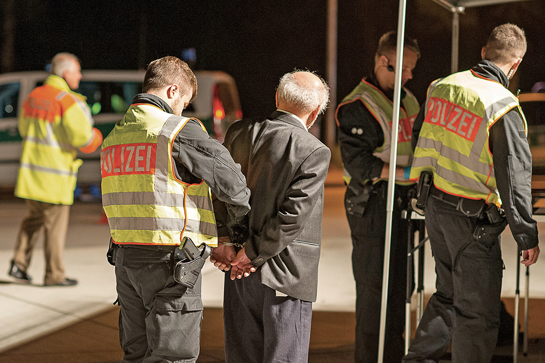 Bavarian State Police arrest a man near Passau on suspicion of smuggling migrants from Austria into Germany in 2015. GETTY IMAGES