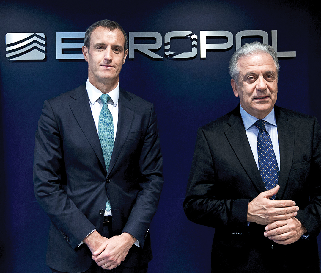 Rob Wainwright, left, director of Europol, and Dimitris Avramopoulos, European Union commissioner for migration, home affairs and citizenship, meet at Europol headquarters in The Hague in February 2016. They discussed EU efforts to counter migrant smuggling by organized crime groups. AFP/GETTY IMAGES
