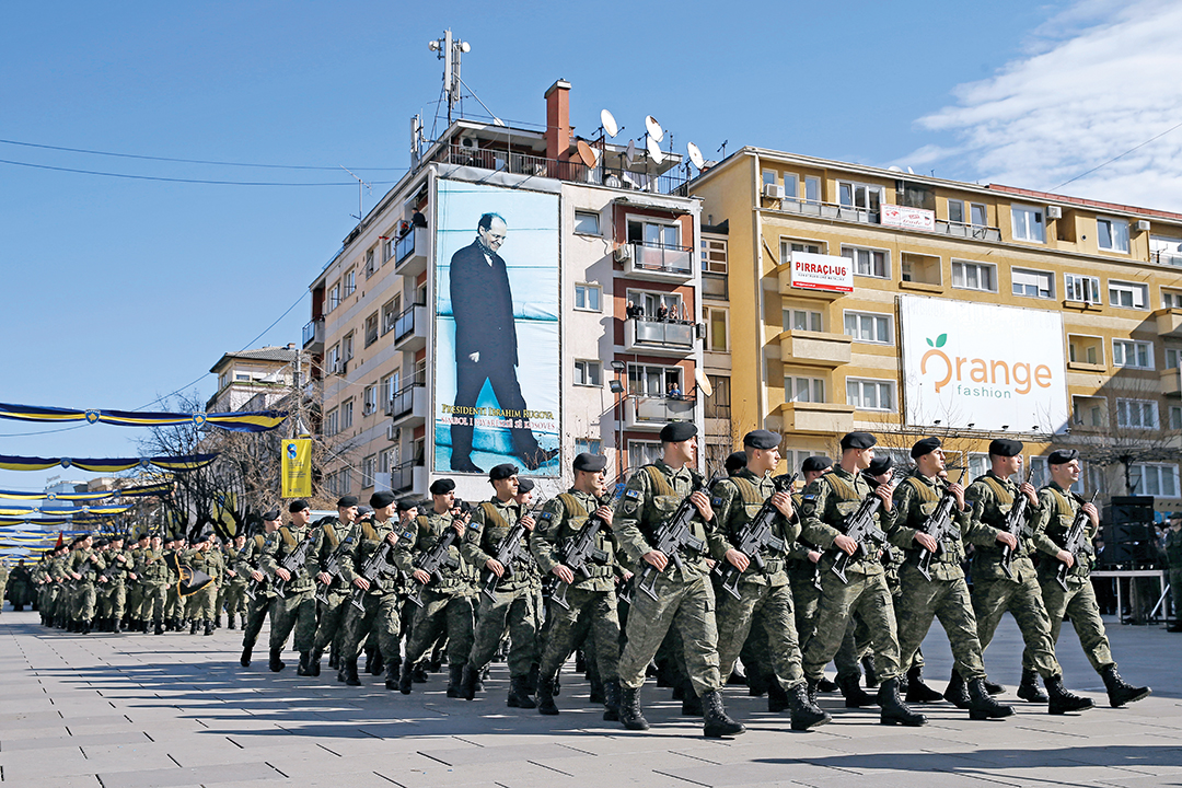 Members of the Kosovo Security Forces march in Pristina in February 2016, celebrating the eighth anniversary of Kosovo's declaration of independence from Serbia. [REUTERS]