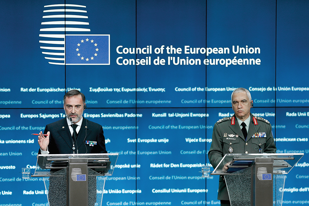 Italian Rear Adm. Enrico Credendino, left, commander of the European Union Naval Force Mediterranean, and Gen. Mikhail Kostarakos, chief of general staff of the Greek Armed Forces, brief the media in Brussels in December 2015 about combating trafficking and smuggling of migrants in the Mediterranean Sea. EPA